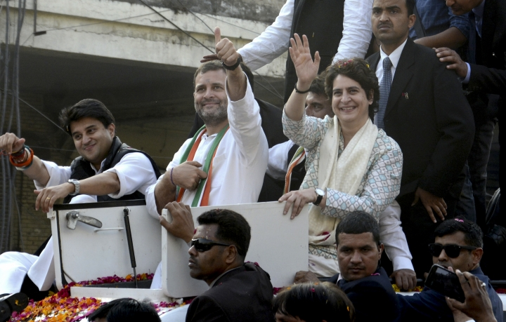 FILE - In this Feb. 11, 2019 file photo, India's Congress party President Rahul Gandhi, center, gestures with the party's general secretaries Priyanka Gandhi Vadra, right, and Jyotiraditya Scindia, left, by his side during a rally in Lucknow, India. Political observers in India are examining whether the scion of the country's most important modern political dynasty can retain a seat in Parliament and revive his party's fortunes. With India's marathon general election inching toward the finish line, opposition Congress party leader Rahul Gandhi is beginning to seem like more of a credible leader. But it's unclear whether the 48-year-old has done enough to defeat Prime Minister Narendra Modi. (AP Photo/Nirala Tripathi)