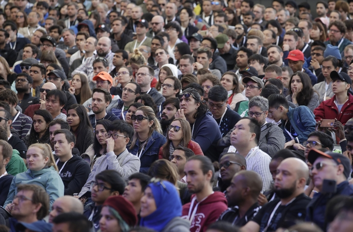 Attendees listen to speakers during the keynote address of the Google I/O conference in Mountain View, Calif., Tuesday, May 7, 2019. (AP Photo/Jeff Chiu)