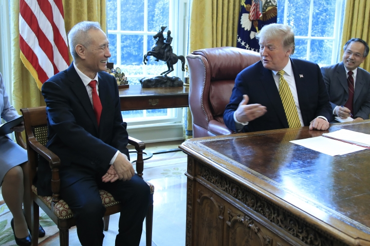 FILE - In this April 4, 2019, file photo, President Donald Trump meets China's Vice Premier Liu He in the Oval Office of the White House in Washington. (AP Photo/Manuel Balce Ceneta, File)
