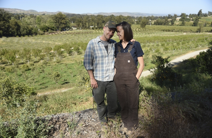 "This April 17, 2019 photo shows John Chester, left, and his wife Molly, of the documentary film ""The Biggest Little Farm,"" at Apricot Lane Farms in Moorpark, Calif. (Photo by Chris Pizzello/Invision/AP)"