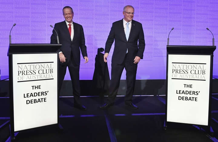 Australian Prime Minister Scott Morrison, right, and Bill Shorten, leader of the federal opposition, arrive on stage before the third leaders debate at the National Press Club in Canberra, Wednesday, May 8, 2019. Australia will have a national election on May 18. (Mick Tsikas/AAP Image via AP)