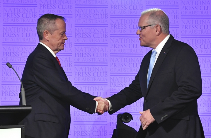 Australian Prime Minister Scott Morrison, right, and Bill Shorten, leader of the federal opposition, shake hands before the third leaders debate at the National Press Club in Canberra, Wednesday, May 8, 2019. Australia will have a national election on May 18. (Mick Tsikas/AAP Image via AP)