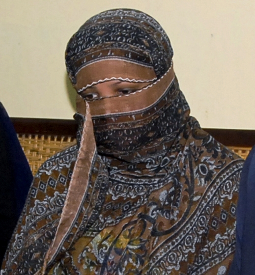 "FILE - In this Nov. 20, 2010, file photo, Aasia Bibi, a Pakistani Christian woman, listens to officials at a prison in Sheikhupura near Lahore, Pakistan. Pakistani media say Aasia Bibi, a Christian woman acquitted of blasphemy after spending eight years on death row, has left Pakistan for Canada to be reunited with her daughters. Wilson Chawdhry of the British Pakistani Christian Association told The Associated Press on Wednesday, May 8, 2019, he received a telephone text message from a British diplomat stating simply that ""Aasia is out."" (AP Photo, File)"