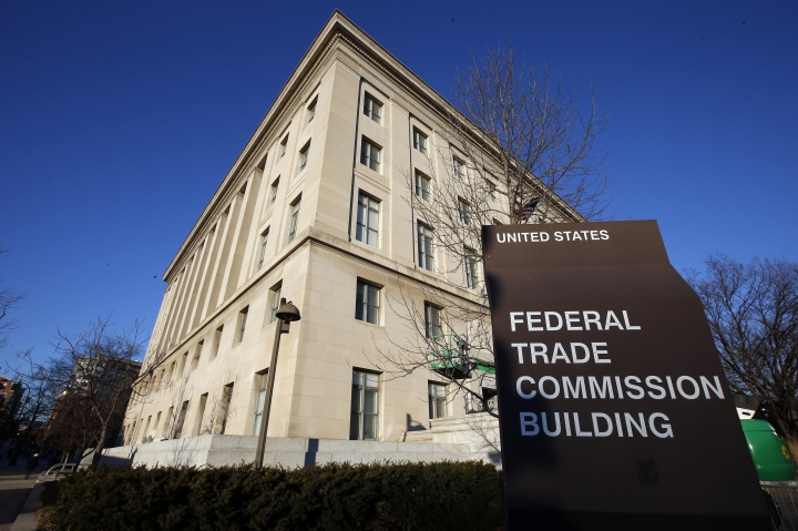 FILE - This Jan. 28, 2015, file photo, shows the Federal Trade Commission building in Washington. Federal privacy regulators are under scrutiny in Congress as they negotiate a record fine with Facebook to punish the company for alleged violations of its users' privacy. (AP Photo/Alex Brandon, File)