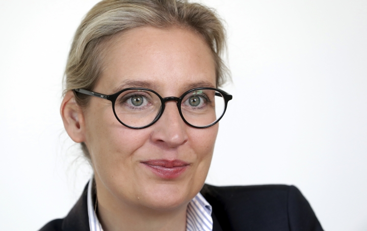 In this Tuesday, May 7, 2019 photo Alice Weidel, co-faction leader of the Alternative for Germany party (AfD) at the German federal parliament, Bundestag, attends an AP interview in Berlin, Germany. (AP Photo/Michael Sohn)