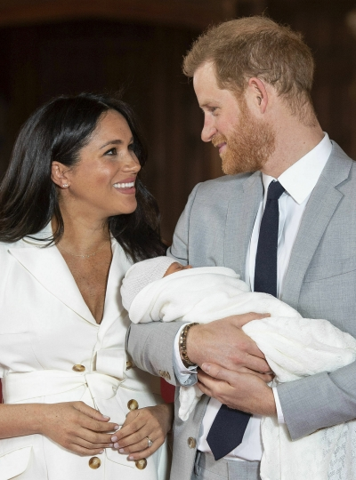 """Britain's Prince Harry and Meghan, Duchess of Sussex, during a photocall with their newborn son, in St George's Hall at Windsor Castle, Windsor, south England, Wednesday May 8, 2019. Baby Sussex was born Monday at 5:26 a.m. (0426 GMT; 12:26 a.m. EDT) at an as-yet-undisclosed location. An overjoyed Harry said he and Meghan are """"thinking"""" about names. (Dominic Lipinski/Pool via AP)"""
