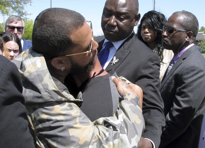 Anthony Colon, left, comforts Jose Vega, whose son was killed by a police officer, on Wednesday, May 8, 2019, in Wethersfield, Conn. Relatives and lawyers gathered in front of the police department to decry the killing of Anthony Jose Vega Cruz by Wethersfield Officer Layau Eulizier on April 20. Eulizier's lawyer said the shooting was justified. (AP Photo/Dave Collins)