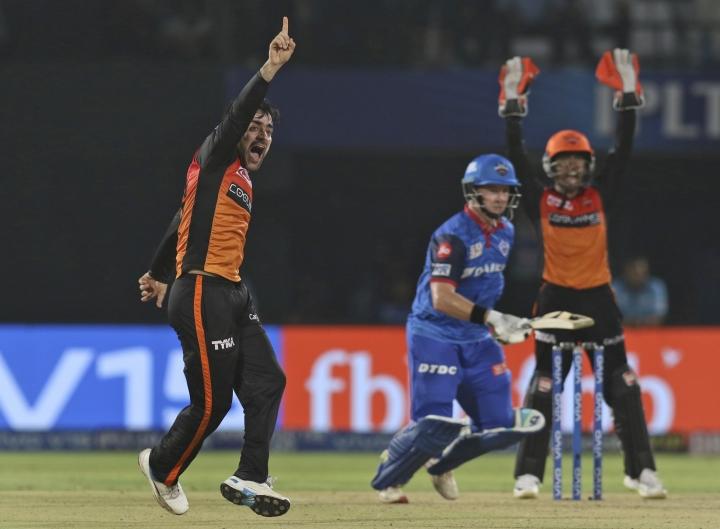 Rashid Khan of Sunrisers Hyderabad celebrates the wicket of Colin Munro of Delhi Capitals during the VIVO IPL T20 cricket eliminator match between Delhi Capitals and Sunrisers Hyderabad in Visakhapatnam India, Wednesday, May 8, 2019. (AP Photo/Surjeet Yadav)