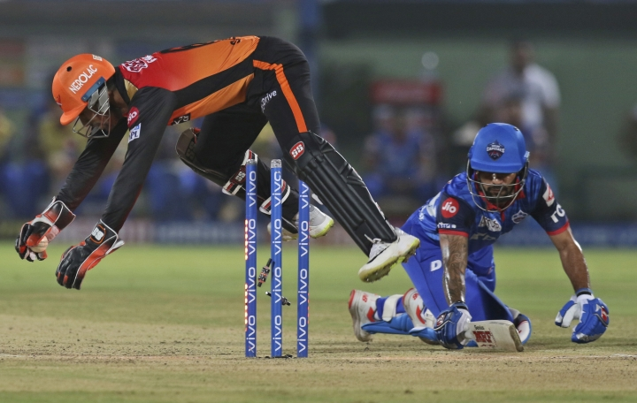 Wriddhiman Saha of Sunrisers Hyderabad, left, stumps out Shikhar Dhawan of Delhi Capitals during the VIVO IPL T20 cricket eliminator match between Delhi Capitals and Sunrisers Hyderabad in Visakhapatnam India, Wednesday, May 8, 2019. (AP Photo/Surjeet Yadav)