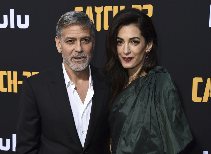 """George Clooney and Amal Clooney arrive at the Los Angeles premiere of """"Catch-22"""" at TCL Chinese Theatre on Tuesday, May 7, 2019. (Photo by Jordan Strauss/Invision/AP)"""