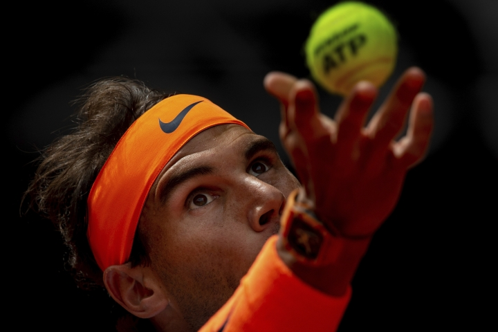 Rafael Nadal, from Spain, serves to Felix Auger-Aliassime, from Canada, during the Madrid Open tennis match in Madrid, Wednesday, May 8, 2019. (AP Photo/Bernat Armangue)