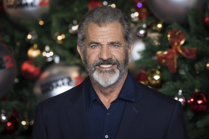 "FILE - This Nov. 16, 2017 file photo shows actor Mel Gibson at the premiere of ""Daddys Home 2,"" in London. Gibson is to play Santa Claus in ""Fatman,"" a comedy that will be shopped at the upcoming Cannes Film Festival. He is attached as Kris Kringle in the film to be directed by Ian and Eshom Nelms and is executive produced by David Gordon Green and Danny McBride. (Photo by Vianney Le Caer/Invision/AP, File)"