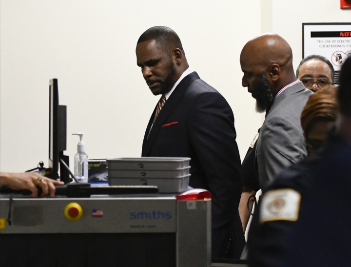 Musician R. Kelly, center, goes through security after he arrives at the Daley Center for a hearing in his child support case on Wednesday, May 8, 2019, in Chicago. (AP Photo/Matt Marton)