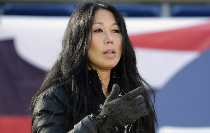FILE - In this Dec. 23, 2018, file photo, Buffalo Bills co-owner Kim Pegula stands on the field as the team warms up before an NFL football game against the New England Patriots, in Foxborough, Mass. A person with direct knowledge of the decision tells The Associated Press that Kim Pegula, also owner of the Buffalo Beauts, has given up control of the National Women's Hockey League franchise. The person spoke to The AP on Wednesday, May 8, 2019, on the condition of anonymity because the decision won't be announced until later in the day. The person said Beauts owner Kim Pegula informed NWHL Commissioner Dani Rylan of her decision during a conference call Tuesday. (AP Photo/Steven Senne, File)