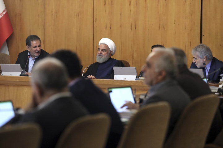In this photo released by the official website of the office of the Iranian Presidency, President Hassan Rouhani, center, heads a cabinet meeting in Tehran, Iran, Wednesday, May 8, 2019. Rouhani said Wednesday that it will begin keeping its excess uranium and heavy water from its nuclear program, setting a 60-day deadline for new terms to its nuclear deal with world powers before it will resume higher uranium enrichment. (Iranian Presidency Office via AP)
