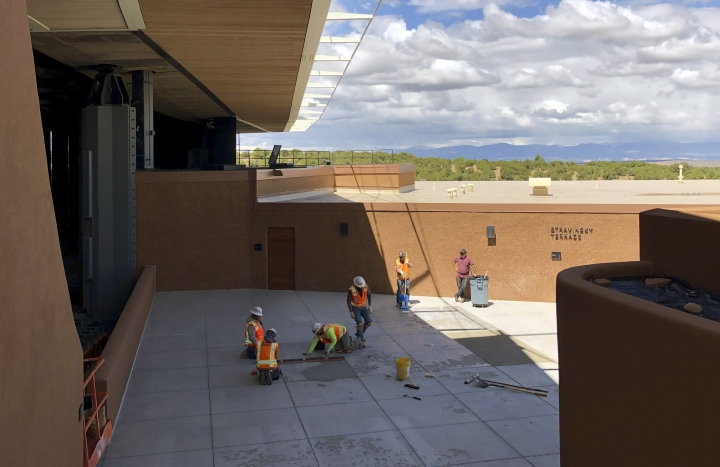 "Construction workers make final preparations for the summer season at the Santa Fe Opera, Wednesday, May 8, 2019, in Santa Fe, N.M. Opera General Director Robert Meya announced they will stage the world premiere in 2020 of the gender-bending story ""M. Butterfly"" from playwright and librettist David Henry Hwang. (AP Photo/Morgan Lee)"