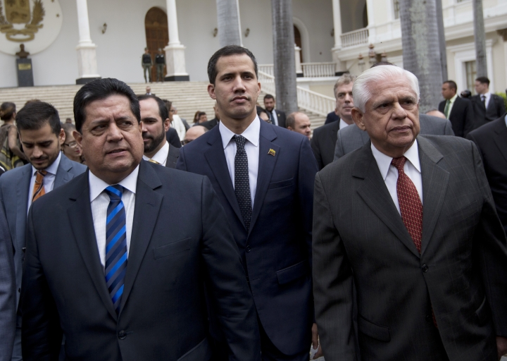 FILE - In this Jan. 5, 2019 file photo, incoming National Assembly Vice President Edgar Zambrano, left, arrives with incoming National Assembly President Juan Guaido, center, and Omar Barboza, outgoing president of Venezuela's National Assembly, to a special session at the Assembly in Caracas, Venezuela. Zambrano was arrested on Wednesday, May 8, 2019, according to Carlos Prosperi, leader of the Democratic Action party, who said Zambrano was in his car when it was surrounded by heavily armed police outside the party's headquarters. His arrest follows a government announcement that Zambrano and several other lawmakers were under investigation for treason and instigating an insurrection. (AP Photo/Fernando Llano, File)
