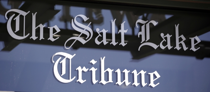 In this April 20, 2016, file photo, shows the Salt Lake Tribune sign in Salt Lake City. The Salt Lake Tribune has announced plans to become a nonprofit as it moves toward a nontraditional model that it hopes will ensure long term stability after years of financial struggles. Salt Lake Tribune editor Jennifer Napier-Pearce said Wednesday, May 8, 2019, the move is aimed at finding a better way to fund the newspaper's operations because declines in advertising and circulation revenues that have plagued the industry seem irreversible. (AP Photo/Rick Bowmer, File)