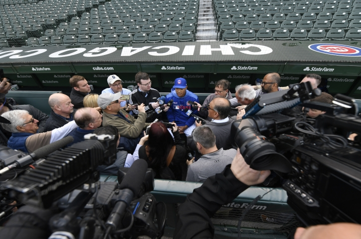 Chicago Cubs shortstop Addison Russell speaks to the media in the dugout before a baseball game against the Miami Marlins, Wednesday, May 8, 2019, in Chicago. Russell rejoins the team after completing a 40-game suspension for violating Major League Baseball's domestic violence policy and spending extra time in the minors to get ready. (AP Photo/Paul Beaty)