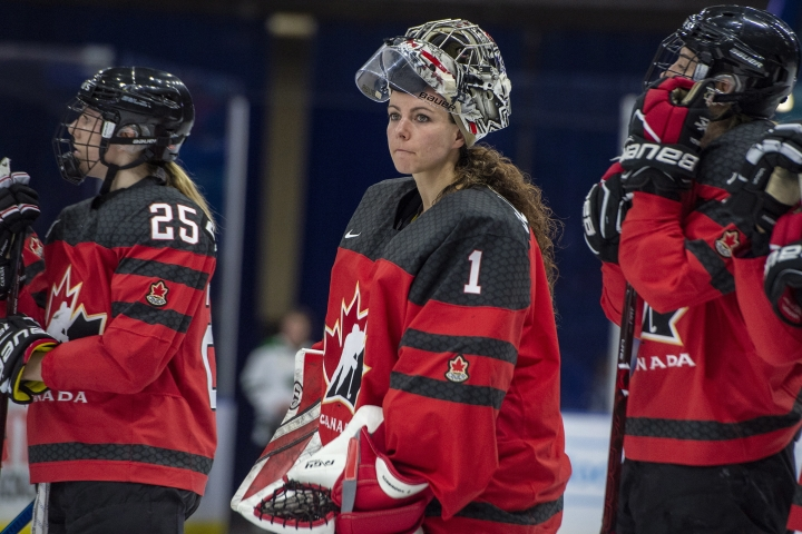 FILE - In this Nov. 10, 2018, file photo, Canada goaltender Shannon Szabados watches as U.S. players celebrate during the Four Nations Cup hockey gold-medal game in Saskatoon, Saskatchewan. A person with direct knowledge of the decision tells The Associated Press that the owner of the Buffalo Beauts has given up control of the National Women's Hockey League franchise. The person spoke to The AP on Wednesday, May 8, 2019, on the condition of anonymity because the decision won't be announced until later in the day. This further jeopardizes the league's future as it struggles to keep its five franchises afloat, and without the support of the world's top players. On Thursday, the NWHL learned it will have difficulty restocking its rosters after more than 200 of the world's top female players pledged they'll not compete professionally in North America next season. The group included a vast majority of Beauts players, including U.S. national team defenseman Emily Pfalzer and Canadian national team goalie Shannon Szabados.(Liam Richards/The Canadian Press via AP, File)