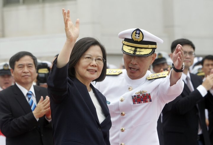 Taiwan's President Tsai Ing-wen, left, waves to Taiwan navy sailors during a groundbreaking ceremony for the island's naval submarine factory in Kaohsiung, southern Taiwan, Thursday, May 9, 2019. (AP Photo/Chiang Ying-ying)