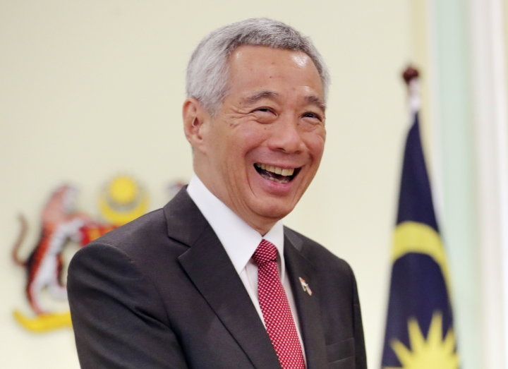 Singaporean Prime Minister Lee Hsien Loong smiles after a press conference with Malaysian Prime Minister Mahathir Mohamad in Putrajaya, Malaysia, Tuesday, April 9, 2019. Singapore reportedly has passed a law criminalizing the publication of fake news and allowing the government to block and order the removal of such content. (AP Photo/Vincent Thian, File)