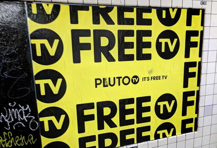 "In this March 14, 2019, photo an advertisement for Pluto TV is displayed on the wall of a subway station in New York. Pluto is unusual in that it also offers dozens of channels with ""live"" video. Though some of these are pretty niche, dedicated to Minecraft or cats, the service is owned by Viacom, so you also get shows from well-known Viacom networks like MTV and Comedy Central. (AP Photo/Tali Arbel)"