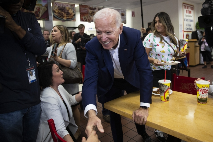 Former vice president and Democratic presidential candidate Joe Biden shakes hands with a patron at King Taco Wednesday, May 8, 2019, in Los Angeles. (AP Photo/Jae C. Hong)