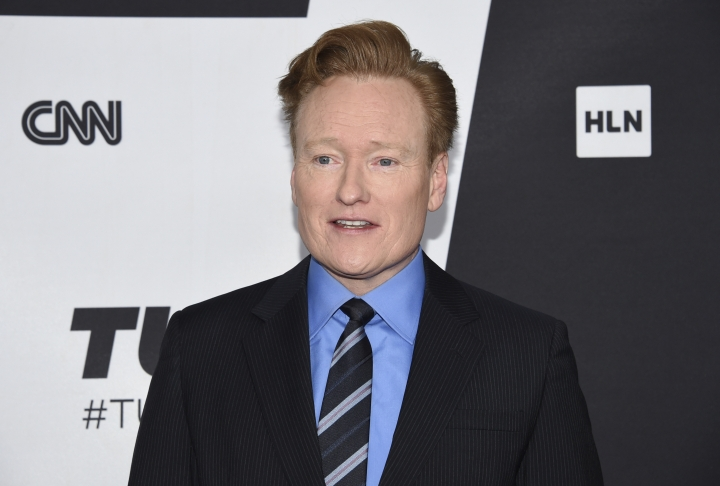 "FILE - This May 16, 2018 file photo shows Conan O'Brien at the Turner Networks 2018 Upfront in New York. O'Brien has agreed to settle a lawsuit with a writer who says the talk-show host stole jokes from his Twitter feed and blog for O'Brien's monologue on ""Conan."" (Photo by Evan Agostini/Invision/AP, File)"