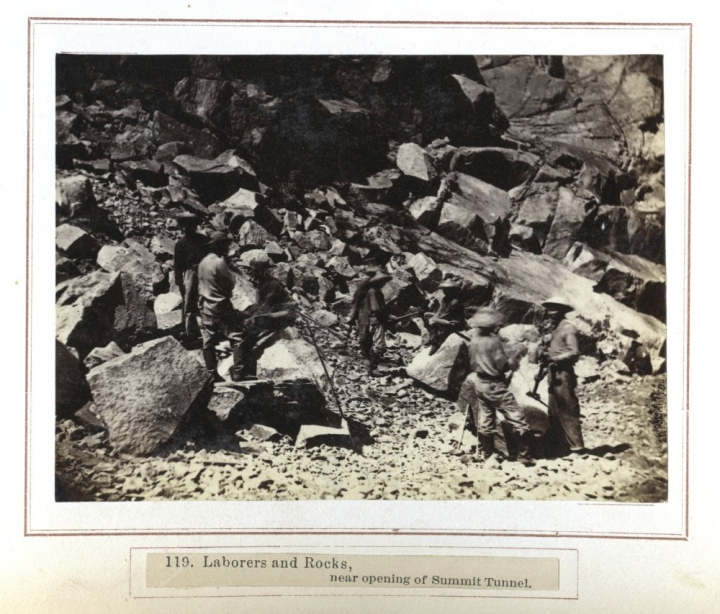 In this photo made between 1862 and 1869, railroad workers, including some Chinese laborers, are seen near an opening of the Summit Tunnel of the Central Pacific Railroad in Northern California. Members of the Chinese Railroad Workers Descendants Association are gathering in Utah in May 2019 to commemorate the 150th anniversary of the railroad's completion. (Alfred A. Hart/Stanford University via AP)
