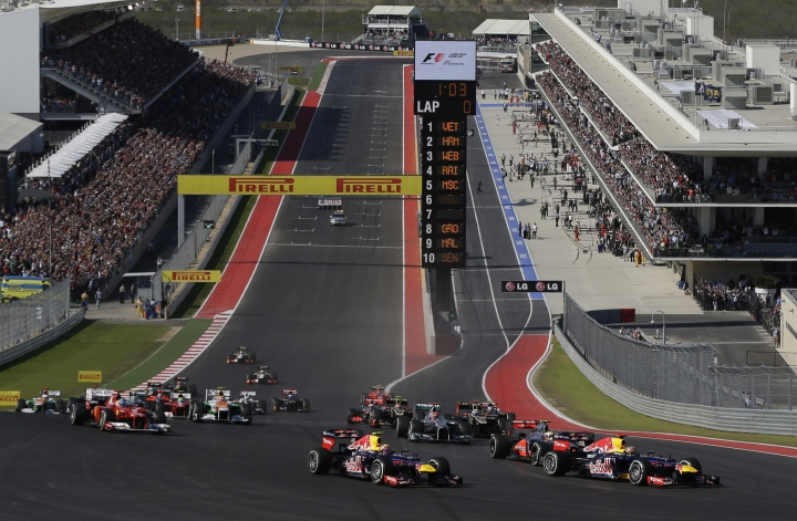 FILE - In this Nov. 18, 2012, file photo, Red Bull driver Sebastian Vettel, right, of Germany U.S. Grand Prix , leads the field into the first turn for the start of the Formula One U.S. Grand Prix auto race at the Circuit of the Americas in Austin, Texas. The promoters of Formula One's U.S. Grand Prix blew a deadline to collect their annual $25 million in Texas taxpayer money to help pay for the 2018 race. Now state lawmakers are about to give them another chance, and make it easier to get the funds in the future. (AP Photo/Eric Gay, File)