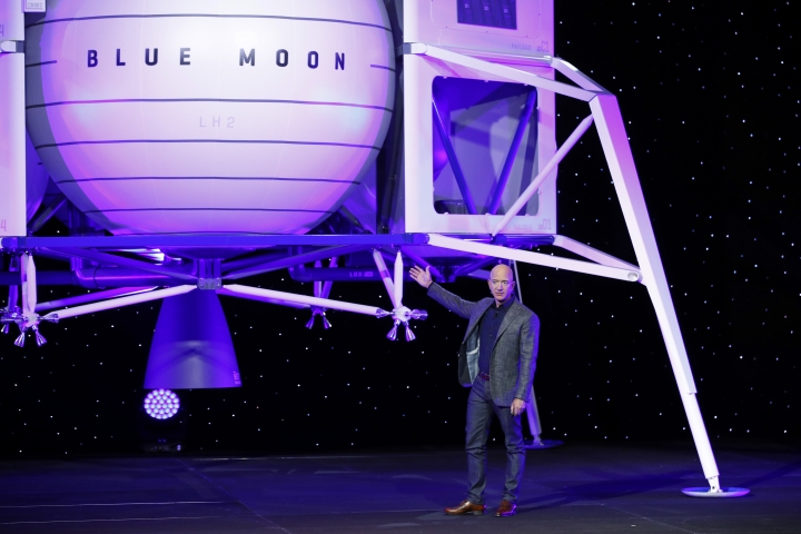 Jeff Bezos speaks in front of a model of Blue Origin's Blue Moon lunar lander, Thursday, May 9, 2019, in Washington. (AP Photo/Patrick Semansky)