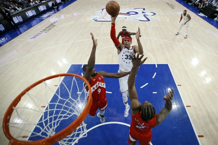 Philadelphia 76ers' Tobias Harris (33) goes up for a shot against Toronto Raptors' Serge Ibaka (9) and Kawhi Leonard (2) during the second half of Game 6 of a second-round NBA basketball playoff series Thursday, May 9, 2019, in Philadelphia. (AP Photo/Chris Szagola)