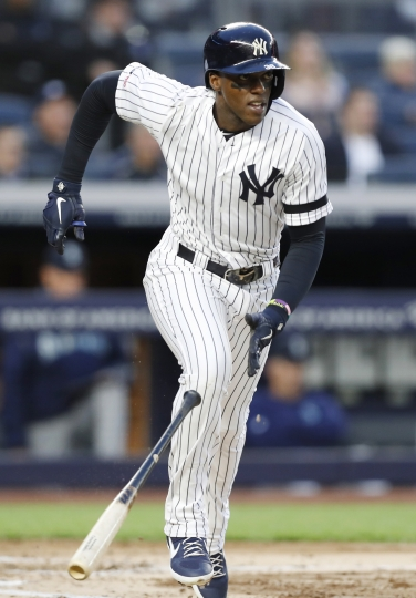 New York Yankees' Cameron Maybin runs on his second-inning RBI double against the Seattle Mariners in a baseball game Thursday, May 9, 2019, in New York. (AP Photo/Kathy Willens)