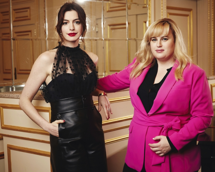 """This April 28, 2019 photo shows Anne Hathaway, left, and Rebel Wilson posing for a portrait in New York to promote their film, """"The Hustle."""" (Photo by Taylor Jewell/Invision/AP)"""