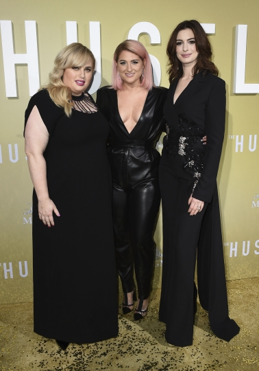 "Rebel Wilson, from left, Meghan Trainor and Anne Hathaway arrive at the Los Angeles premiere of ""The Hustle"" at ArcLight Hollywood on Wednesday, May 8, 2019. (Photo by Jordan Strauss/Invision/AP)"