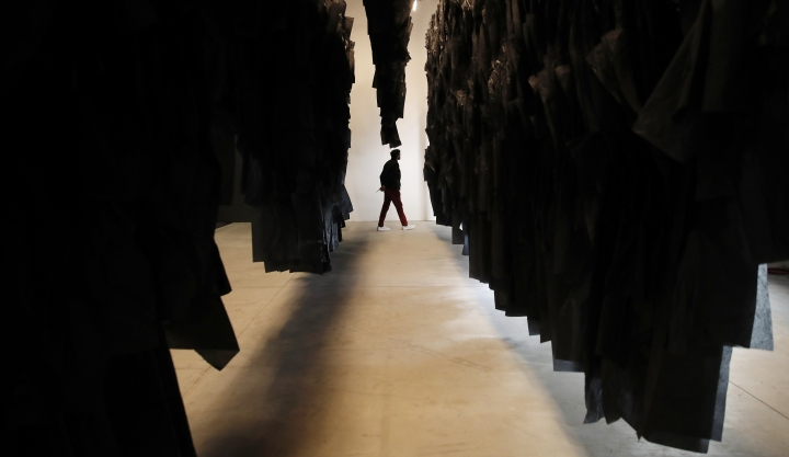 A man walks past an installation at the Madagascar pavilion during the 58th Biennale of Arts exhibition in Venice, Italy, Tuesday, May 7, 2019. Political issues that excite newsprint, airwaves and social media, such as fake news, migration, poverty, global warming and armed conflict, are getting a very open airing at the 58th Venice Biennale contemporary art fair, which Saturday, May 11, and runs through Nov. 24, 2019. (AP Photo/Antonio Calanni)