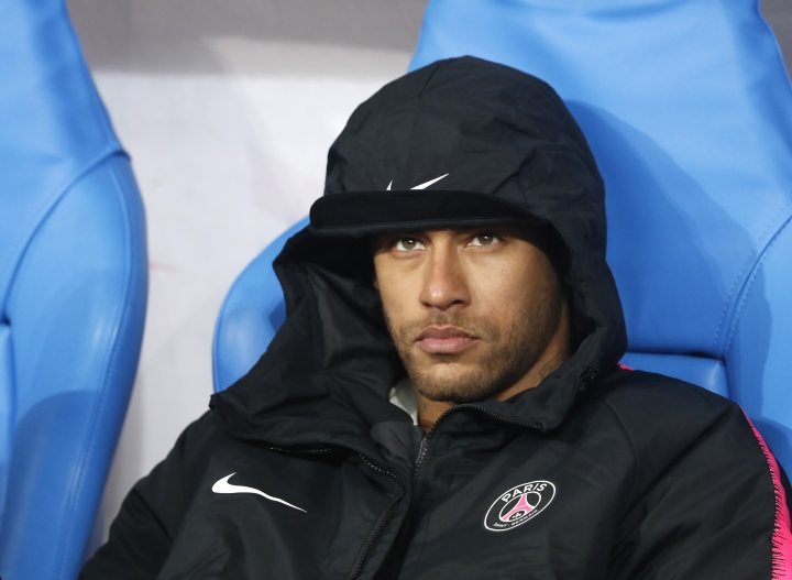 PSG's Neymar sits on the bench after loosing the French Cup soccer final between Rennes and Paris Saint Germain at the Stade de France stadium in Saint-Denis, outside Paris, France, Saturday, April 27, 2019. (AP Photo/Thibault Camus)