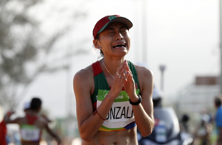 FILE - In this Friday, Aug. 19, 2016 file photo, Maria Guadalupe Gonzalez of Mexico, reacts after crossing the finish line in second place in the women's 20-km race walk at the 2016 Summer Olympics in Rio de Janeiro, Brazil. Olympic silver medalist race walker Maria Guadalupe Gonzalez has been banned for four years for doping with anabolic steroids. The Athletics Integrity Unit, which prosecutes cases for the IAAF governing body, says the Mexican walker's ban took effect last Nov. 16, 2018. (AP Photo/Robert F. Bukaty, File)
