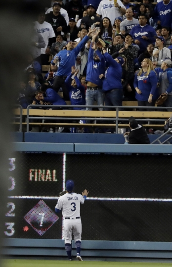 Los Angeles Dodgers left fielder Chris Taylor watches a home run by Washington Nationals' Howie Kendrick go over the wall during the first inning of a baseball game Thursday, May 9, 2019, in Los Angeles. (AP Photo/Marcio Jose Sanchez)
