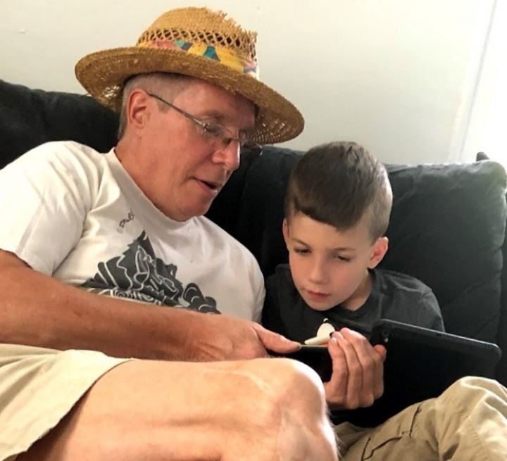 "This summer 2018 photo provided by Al Mattin on Friday, May 10, 2019 shows his father, Stephen, and son, Ronan, at Stephen's home in Kensington, N.H. The Handel & Haydn Society had just finished a rendition of Mozart's ""Masonic Funeral"" at Boston's Symphony Hall on Sunday, May 5, 2019 when a youngster blurted out: ""WOW!"" The group was so charmed that they launched a search. Stephen Mattin, who attended the concert with Ronan said he is on the autism spectrum and expresses himself differently from how other people do. He said his grandson is a huge music fan. (Al Mattin via AP)"