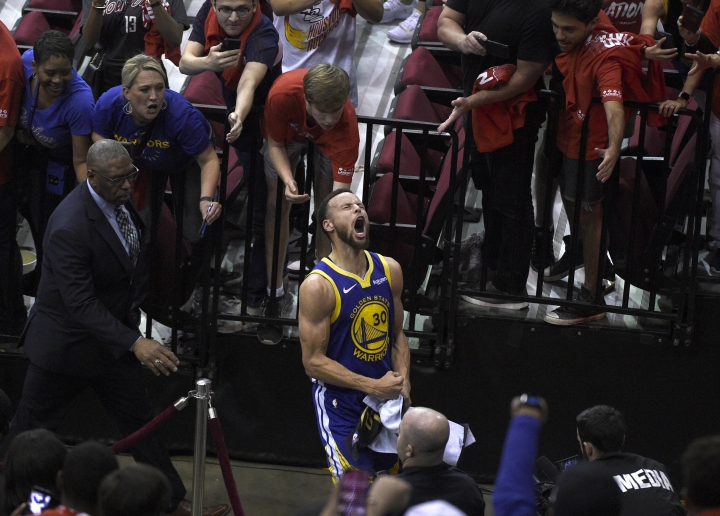 Golden State Warriors' Stephen Curry celebrates as he walks off the court following the team's 118-113 win against the Houston Rockets during Game 6 of a second-round NBA basketball playoff series, Friday, May 10, 2019, in Houston. (AP Photo/Eric Christian Smith)