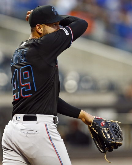 Miami Marlins pitcher Pablo Lopez reacts between pitches during the first inning of the team's baseball game against the New York Mets on Friday, May 10, 2019, in New York. (AP Photo/Adam Hunger)