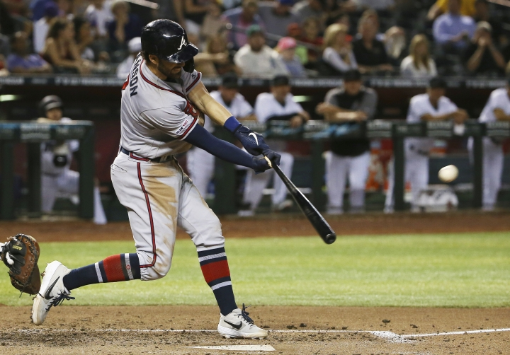 Atlanta Braves' Dansby Swanson connects for a triple against the Arizona Diamondbacks during the fourth inning of a baseball game Friday, May 10, 2019, in Phoenix. (AP Photo/Ross D. Franklin)