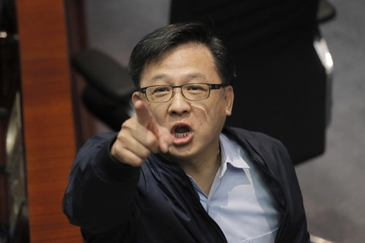 Pro-Beijing lawmaker Junius Ho argues with spectators in the chamber at Legislative Council in Hong Kong, Saturday, May 11, 2019. Hong Kong's legislative assembly descended into chaos Saturday as lawmakers for and against controversial amendments to the territory's extradition law clashed over access to the chamber. (AP Photo/Kin Cheung)