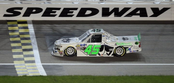 Ross Chastain crosses the finish line to win the NASCAR Truck Series auto race at Kansas Speedway in Kansas City, Kan., Friday, May 10, 2019. (AP Photo/Orlin Wagner)