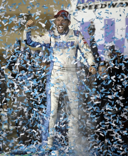 Ross Chastain celebrates in Victory Lane after winning the NASCAR Truck Series auto race at Kansas Speedway in Kansas City, Kan., Friday, May 10, 2019. (AP Photo/Orlin Wagner)