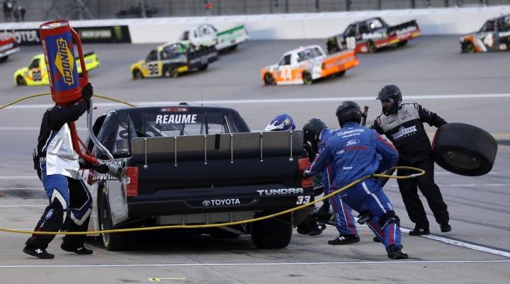 Josh Reaume pits during the NASCAR Truck Series auto race at Kansas Speedway in Kansas City, Kan., Friday, May 10, 2019. (AP Photo/Colin E. Braley)