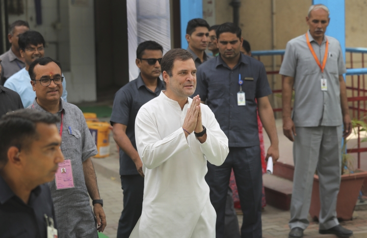 Congress party president Rahul Gandhi, center, greets media after casting his vote during the sixth phase of general elections in New Delhi, India, Sunday, May 12, 2019. Indians are voting in the next-to-last round of 6-week-long national elections, marked by a highly acrimonious campaign with Prime Minister Narendra Modi flaying the opposition Congress party rival Rahul Gandhi's family for the country's ills. (AP Photo/Manish Swarup)