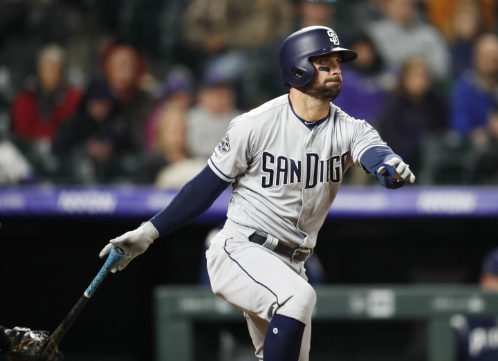 San Diego Padres' Greg Garcia hits a grounder with the bases loaded to drive in the go-ahead run in the ninth inning of the team's baseball game against the Colorado Rockies on Saturday, May 11, 2019, in Denver. San Diego won 4-3. (AP Photo/David Zalubowski)